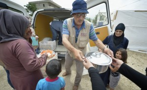 Abdul Aarnous and other staff of International Orthodox Christian Charities unload food for families in a settlement of Syrian refugees in Minyara, a village in the Akkar district of northern Lebanon. Lebanon hosts some 1.5 million refugees from Syria, yet allows no large camps to be established. So refugees have moved into poor neighborhoods or established small informal settlements in border areas. A member of the ACT Alliance, IOCC provides a variety of support for families in this settlement, including food prepared in a community kitchen.